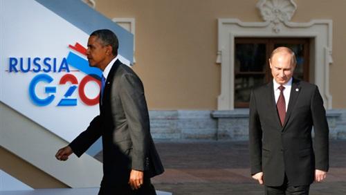 أوباما يتهم بوتين