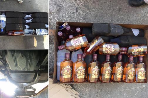 إحباط تهريب 156 زجاجة خمر بجمرك جسر الملك فهد