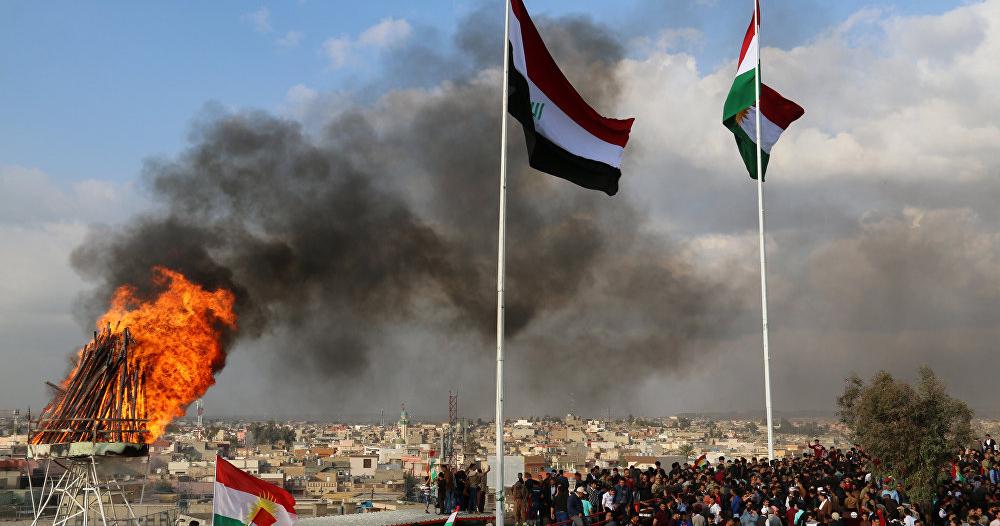 متظاهرون يحرقون مقرات الأحزاب الكردية بالعراق