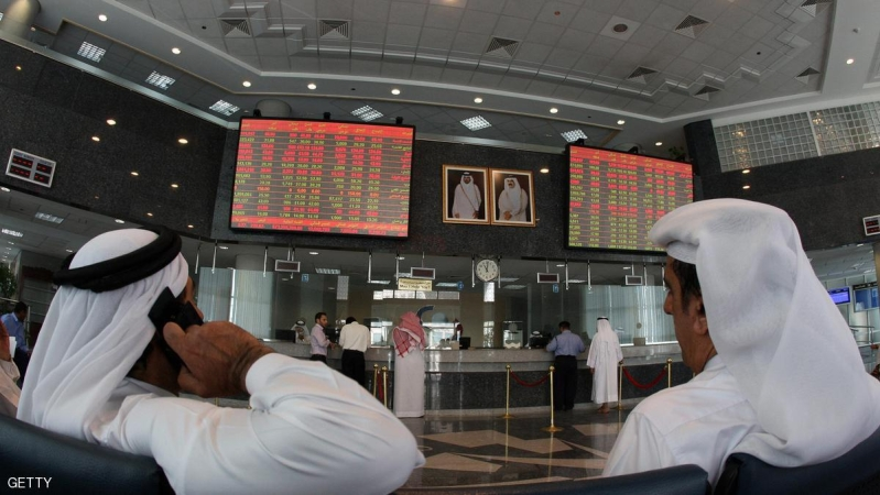 Investors follow the stock market activity on monitors at the Doha Securities Market in the Qatari capital on September 16, 2008. Global equities tumbled for a second day running today as anxious investors waited to see if US insurance giant American International Group (AIG) would suffer the same fate as bankrupt US investment bank Lehman Brothers. AFP PHOTO/KARIM JAAFAR (Photo credit should read KARIM JAAFAR/AFP/Getty Images)
