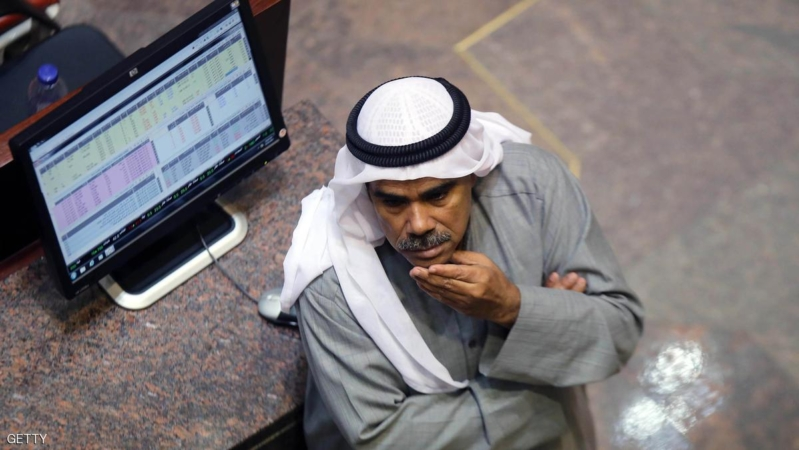 A Kuwaiti traders follows the stock market at the Kuwaiti Stock Exchange (KSE) in Kuwait City on December 31, 2014. Stock markets in the energy-rich Gulf states dived in the fourth quarter due to the slump in oil prices after posting strong gains in the first nine months of 2014.  AFP PHOTO / YASSER AL-ZAYYAT        (Photo credit should read YASSER AL-ZAYYAT/AFP/Getty Images)