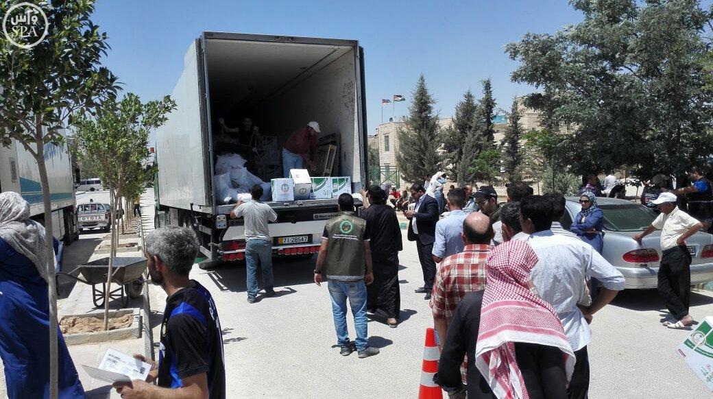 الحملة الوطنية توزع 24 ألف وجبة إفطار على اللاجئين السوريين (3)