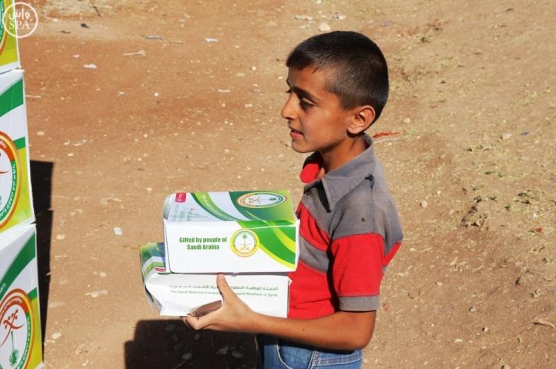 الحملة الوطنية توزع 24 ألف وجبة إفطار على اللاجئين السوريين (4)