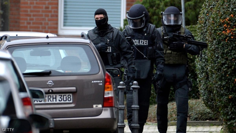 ALSDORF, GERMANY - NOVEMBER 17:  Heavily-armed members of the German SEK special forces police unit stand outside a house in Schaufenberger Strasse street where they possibly made two arrests on November 17, 2015 in Alsdorf, Germany. Police announced earlier today that a unit of the SEK special forces had in a separate incident arrested two men and one woman at 9:30 this morning in connection with the recent terror attacks in Paris in the parking lot of a Jobcenter employment office. So far it is unclear who the suspects are though initial reports indicate Salah Abdeslam, a brother of a man who took part in the attacks and whom police are searching for across Europe, is not among them.  (Photo by Sascha Steinbach/Getty Images)