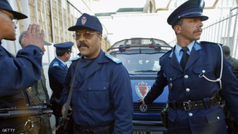 Rabat, MOROCCO: A police car arrives 27 March 2007 at the court house of Rabat with some of the 24 suspects after suicide bomber Abdelfettah Raydi blew himself 11 March 2007 in a Casablanca internet cafe, wounding a suspected accomplice along with three other people. The 24 suspects were accused and jailed Today.  AFP PHOTO/ABDELHAK SENNA (Photo credit should read ABDELHAK SENNA/AFP/Getty Images)