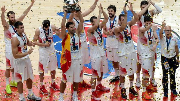 Spain's power forward Felipe Reyes (4thy L) holds the winner's trophy after Spain won the final basketball match between Spain and Lithuania at the EuroBasket 2015 in Lille, northern France, on September 20, 2015.    AFP PHOTO / DENIS CHARLET        (Photo credit should read DENIS CHARLET/AFP/Getty Images)