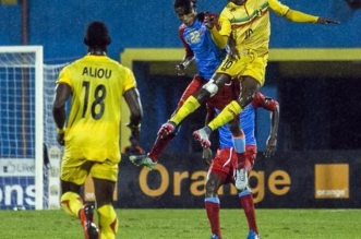 DR Congo's Yannick Bangala (2nd L) and Mali's Mamadou Coulibaly( R) vies for the ball  during the African Nations Championship (CHAN) football final match between DR Congo's Leopards and Mali's Eagles on February 7, 2016 in Kigali. / AFP / CYRIL NDEGEYA        (Photo credit should read CYRIL NDEGEYA/AFP/Getty Images)