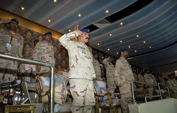 اللواء الطيار الركن عبداللطيف الشريم خلال تحية علم اللواء في الافتتاح