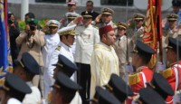 King Mohammed VI of Morocco (R), followed by his brother Prince Moulay Rachid (L), review troops during a ceremony to mark the anniversary of his 1999 coronation at the Tetouan palace, northern Morocco, on July 31, 2011.   AFP PHOTO/ ABDELHAK SENNA (Photo credit should read ABDELHAK SENNA/AFP/Getty Images)