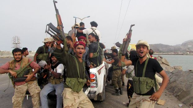 Southern Resistance fighters react as they prepare to go to the frontline of fighting against Houthis in Yemen's southern port city of Aden July 16, 2015. Local fighters have wrested Yemen's airport and main seaport from the northern militia group in the past two days, in fighting that killed dozens of people, according to medics. By Thursday afternoon, Saudi-backed militiamen battled their way into the centre of Crater district of Aden, the spokesman for anti-Houthi forces in the city told Reuters. REUTERS/Stringer