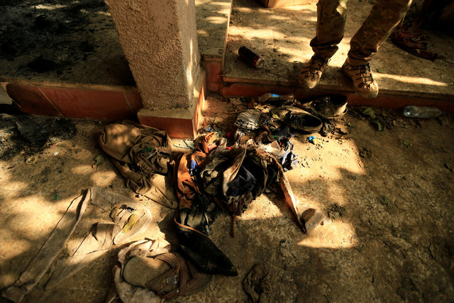 Clothes of prisoners who were detained by Islamic State militants are seen in Hammam al-Ali, south of Mosul, during an operation to attack Islamic State militants in Mosul, Iraq November 7, 2016. REUTERS/Thaier Al-Sudani