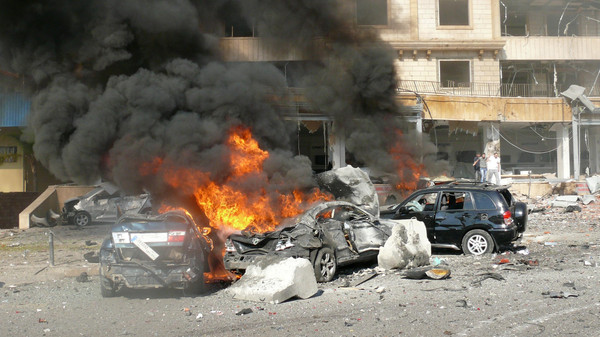 Correcting byline  Flames rise from the wreckage of cars following a bomb explosion in a outhern suburb of the capital Beirut on February 19, 2014. Twin bomb blasts appeared to target the Iranian cultural centre, and an AFP photographer at the scene said the blasts had occurred beyond a security checkpoint at the centre, close to the building. AFP PHOTO / STR