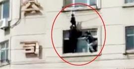 شاهد.. إنقاذ طفلة قبل سقوطها من نافذة شاهقة الارتفاع