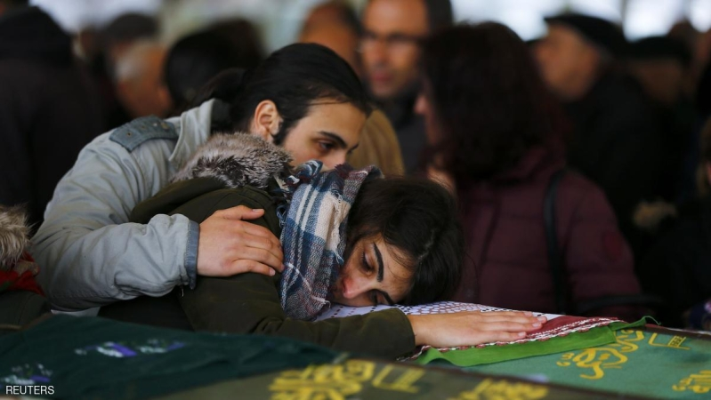 Relatives mourn over the coffin of a car bombing victim during a commemoration ceremony in a mosque in Ankara, Turkey, March 14, 2016. REUTERS/Umit Bektas
