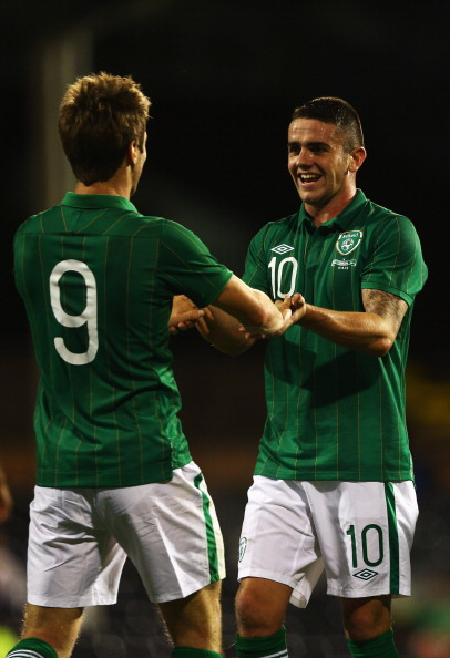 LONDON, ENGLAND - SEPTEMBER 11:  Kevin Doyle of Republic of Ireland celebrates with Robbie Brady after scoring the third goal for Ireland during the International Friendly match between Republic of Ireland and Oman at Craven Cottage on September 11, 2012 in London, England.  (Photo by Paul Gilham/Getty Images)