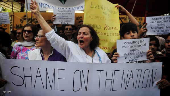 Pakistani human rights activists hold placards in the support of rape victim Mukhtar Mai during a demonstration in Karachi on April 23, 2011. Human Rights Watch called on Pakistan's government to seek a review of the acquittal of five men accused of gang raping a woman in order to punish her brother. Mukhtar Mai, whose case has drawn international outrage, was gang raped in 2002 on orders of a village council after her younger brother -- then 12 -- was wrongly alleged to have had relations with a woman from a rival clan.   AFP PHOTO/Asif HASSAN (Photo credit should read ASIF HASSAN/AFP/Getty Images)