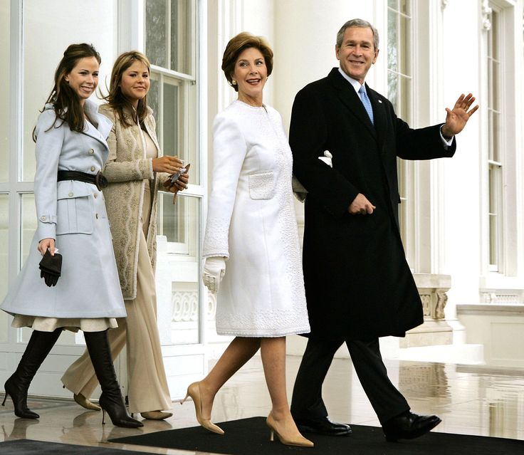 President George W. Bush and first lady Laura Bush depart the North Portico of the White House for the limousine ride to the Capitol where he will take the Oath of Office and begin his second term, in Washington, Thursday, Jan. 20, 2005. They are joined by their daughters Barbara, far left, and Jenna. (AP Photo/J. Scott Applewhite)