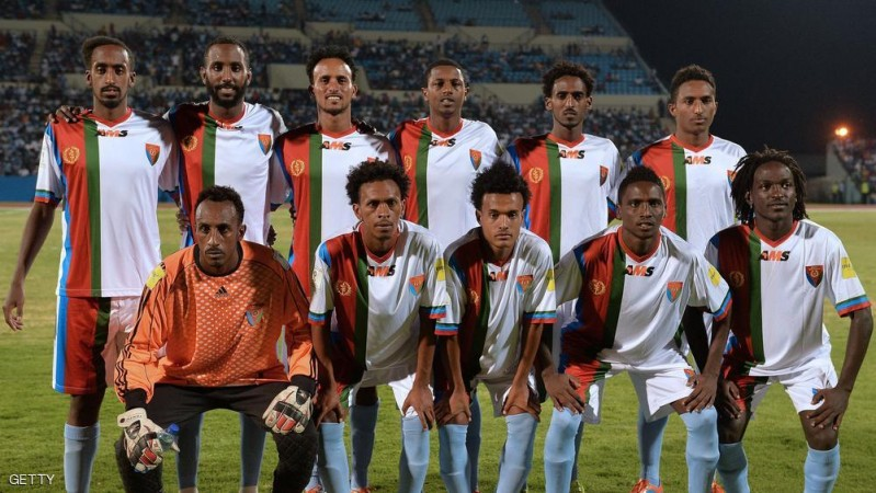 Eritrea national football team players line up for a team photo just before the start of the FIFA World cup qualifying match at Francistown's Stadium on October 13, 2015. Ten footballers from Eritrea's national squad have sought political asylum in Botswana after playing in a qualifying match for the 2018 World Cup, an Eritrean non-governmental organisation said October 16. The players were part of the national team -- known as the Red Sea Camels -- that lost 3-1 to Botswana in Francistown on October 13.  AFP PHOTO / MONIRUL BHUIYAN        (Photo credit should read Monirul Bhuiyan/AFP/Getty Images)