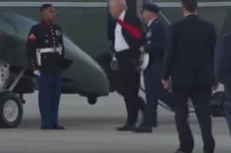 شاهد.. ردة فعل ترامب تجاه جندي مارينز أطاحت الرياح بقبعته! - المواطن