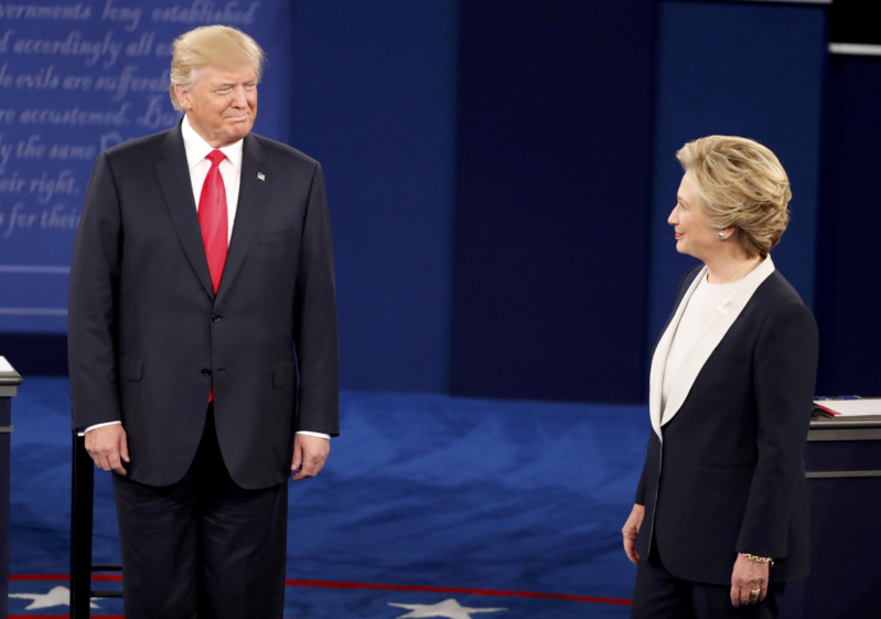 Republican U.S. presidential nominee Donald Trump and Democratic U.S. presidential nominee Hillary Clinton acknowledge each other at the start of their presidential town hall debate at Washington University in St. Louis, Missouri, U.S., October 9, 2016.  REUTERS/Lucy Nicholson