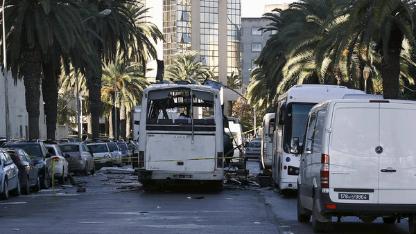 A damaged bus is seen at the scene of a suicide bomb attack in Tunis, Tunisia November 25, 2015.  Tunisian security officials said on Wednesday a suicide bomber carried out the attack on a presidential guard bus, killing at least 13 and forcing the government to impose a nationwide state of emergency.  REUTERS/Zoubeir Souissi