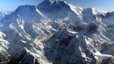 EVEREST HIMALAYAN RANGE, NEPAL - MAY 18: Mount Everest is shown at approximately 8,850-meter (29,035-foot) May 18, 2003 in Nepal. The world's tallest mountain is (back-center) surrounded by Nuptse (R) 8848m and Lhotse, 8576m (L). A record 1,000 climbers plan assaults on the summit as mountaineers celebrate the 50-year anniversary of the conquest of Everest on May 29. (Photo by Paula Bronstein/Getty Images)