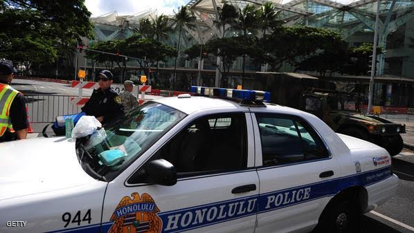 Honolulu police guard road closures around the Convention Center in Honolulu, Hawaii, on November 10 , 2011 during the Asia-Pacific Economic Cooperation (APEC) Summit.  The United States hosts this year's APEC forum for the first time since 1993, with leaders from the 21 member economies convening on the island of Oahu.  AFP PHOTO Robyn BECK (Photo credit should read ROBYN BECK/AFP/Getty Images)