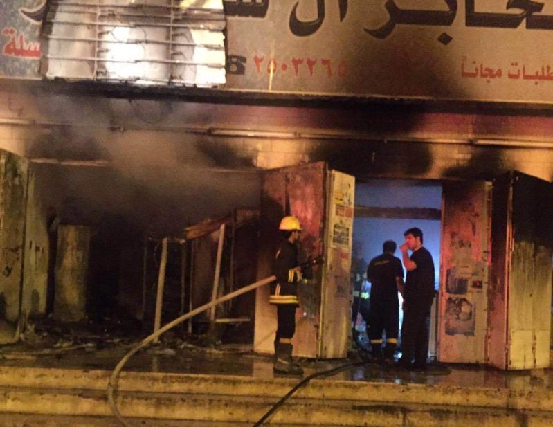 حريق باحدى المحلات التجارية بحي الرصاص بخميس مشيط (3)