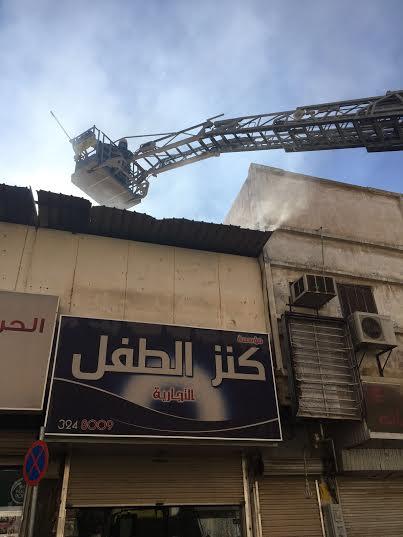 حريق في محل بشارع الصناعة ببريدة2