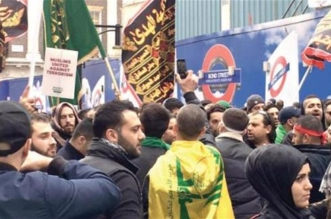 بريطانيا تحقق في رفع أعلام حزب الله في مسيرة عاشوراء - المواطن