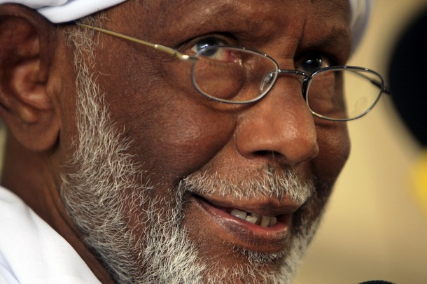 Islamist opposition leader Hassan al-Turabi of the Popular Congress Party addresses a news conference after his visit to Egypt, in Khartoum