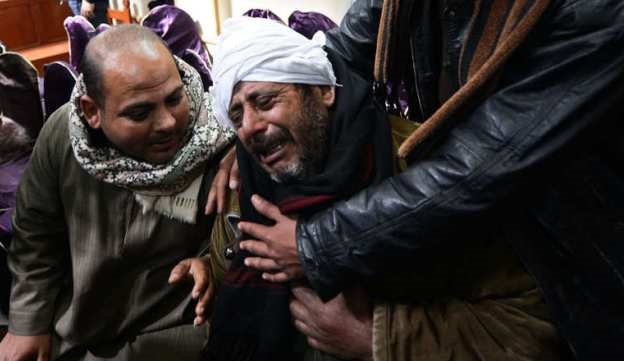 """Relatives of Egyptian Coptic Christians purportedly murdered by Islamic State (IS) group militants in Libya react after hearing the news on February 16, 2015 in the village of Al-Awar in Egypt's southern province of Minya. Egypt's leader vowed to punish the """"murderers"""" responsible for the beheading of 21 Egyptian Christians after the Islamic State group in Libya released a video purportedly showing the mass killing. AFP PHOTO / MOHAMED EL-SHAHED        (Photo credit should read MOHAMED EL-SHAHED/AFP/Getty Images)"""