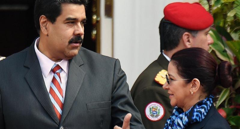 رئيس فنزويلا نيكولاس مادورو وزوجته سيليا فلوريس