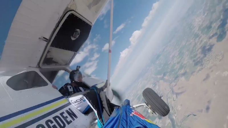 Skydiver is brought to a terrifying halt after catching his wingsuit on a plane