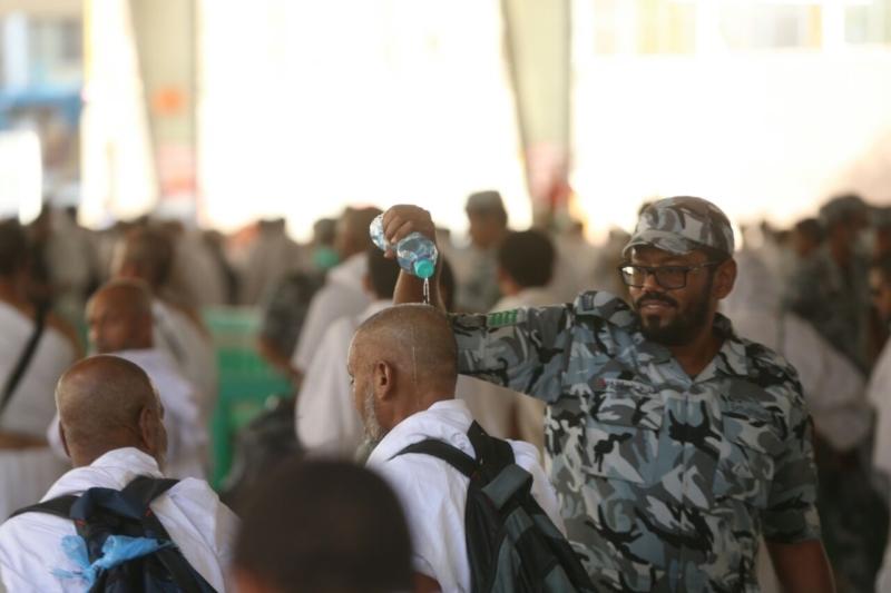 رجال الأمن في خدمة ضيوف الرحمن12