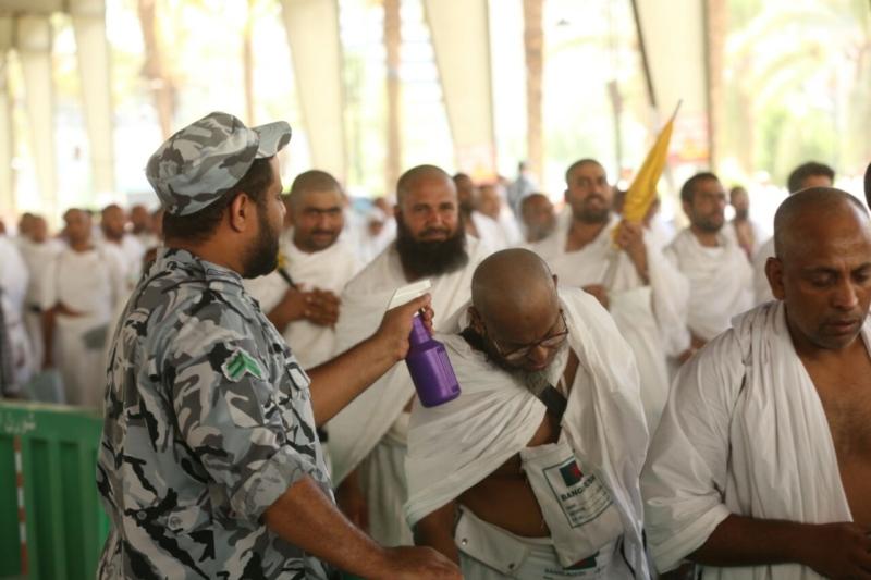 رجال الأمن في خدمة ضيوف الرحمن20
