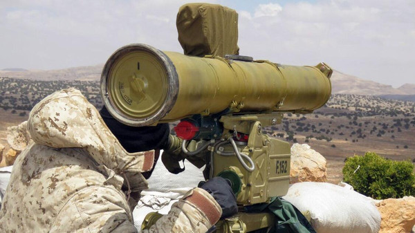 "A handout picture released by the Hezbollah press office on May 13, 2015, shows a Hezbollah fighter aiming his weapon on the Syrian side of the Qalamun hills close to the Lebanese borders. Syrian troops and fighters from Lebanon's Shiite movement Hezbollah captured the highest point in the Qalamun region, a Syrian source on the ground said. AFP PHOTO / HO / HEZBOLLAH PRESS OFFICE == RESTRICTED TO EDITORIAL USE - MANDATORY CREDIT ""AFP PHOTO / HO / HEZBOLLAH PRESS OFFICE"" - NO MARKETING NO ADVERTISING CAMPAIGNS - DISTRIBUTED AS A SERVICE TO CLIENTS =="