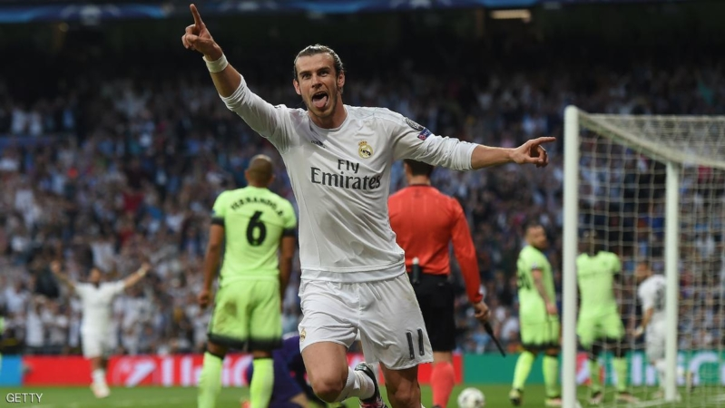 Real Madrid's Welsh forward Gareth Bale celebrates a goal during the UEFA Champions League semi-final second leg football match Real Madrid CF vs Manchester City FC at the Santiago Bernabeu stadium in Madrid, on May 4, 2016. / AFP / PAUL ELLIS        (Photo credit should read PAUL ELLIS/AFP/Getty Images)