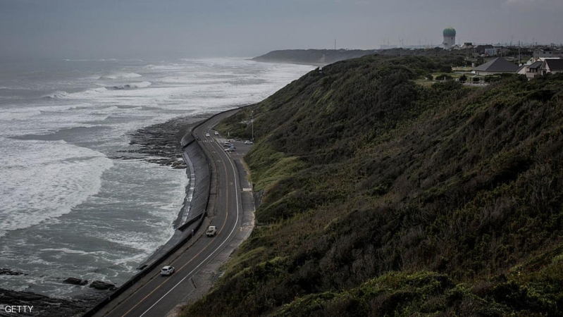 """OMAEZAKI, JAPAN - AUGUST 09:  A general view along the coast road of Omaezaki on August 9, 2014 in Omaezaki, Japan. The town of Omaezaki is living in the shadow of what is said to be, """" the most dangerous nuclear power plant in Japan"""". Hamaoka Nuclear power plant is situated on the coastline in Omaezaki, 200km SW of Tokyo. After the 2011 Earthquake and Tsunami, which crippled the Fukushima Nuclear plant, Hamaoka was shut down by direct request from the then, Japanese prime minister Naoto Kan The plant is in a region of high seismic activity, it is built directly over the subduction zone close to the junction of two tectonic plates. The Tokai region has experienced two great earthquakes in the past, the Tonankai Earthquake in 1944 and the Mikawa earthquake in 1945. Leading researchers have predicted that there is an 87% chance the region will be struck again by a shallow 8+ earthquake within the next 30 years. The Coordinating Committee for Earthquake Prediction upgraded the region to an Area of Intensified Observation in 1974.   Since the plants closure owners Chubu Electric Power Co. have been working on strengthening its defense's against earthquakes and tsunamis. The plant is currently constructing a new 1.6 km breakwater wall reaching 22 meter's above sea level and increasing flood protection for essential equipment and power generators in a bid to comply with new government safety regulations and to gain approval to restart operations.   After the closure of the plant Omaezaki has seen a decrease in business and like many small towns across Japan is seeing a steady decrease in population. The town has now turned its focus to tourism to attract visitors and dollars. Well known for its beautiful beaches, surf locations, and tea plantations, it is however the sea turtle population, which it is most famous for, with many people visiting during the sea turtle hatching season.  (Photo by Chris McGrath/Getty Images)"""