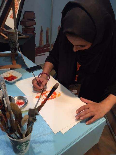 سعودية تُبدع في رسم #خادم_الحرمين بـ الزعفران (4)