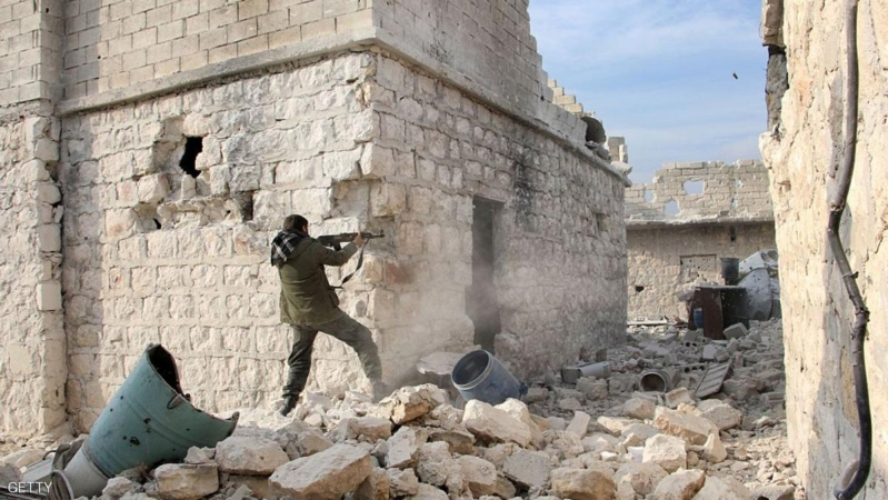 A rebel fighter fires his weapon on the frontline during the battle against pro-government forces for control of the Handarat region, located just north of Aleppo, on December 18, 2014. Handarat has been divided since a rebel offensive in summer 2012 between loyalist sectors in the west of the city and insurgent-held territory in the east. AFP PHOTO / KARAM AL-MASRI        (Photo credit should read KARAM AL-MASRI/AFP/Getty Images)