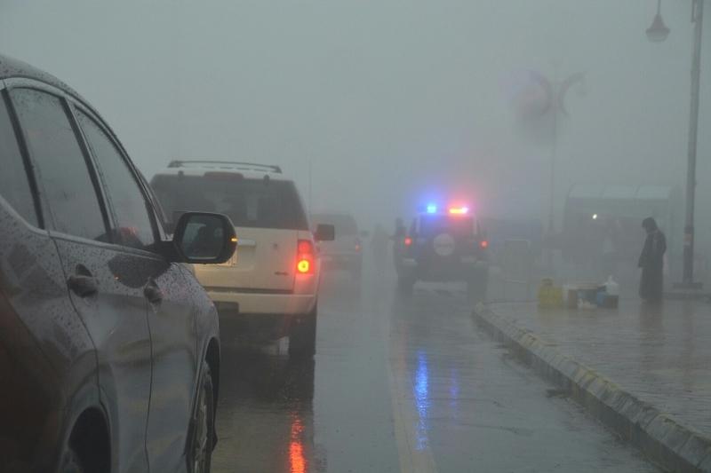 شرطة عسير تحت المطر (14)
