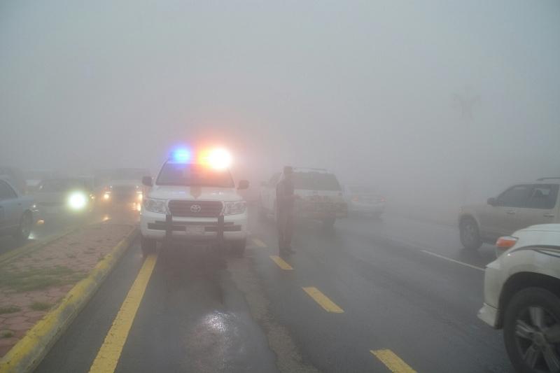 شرطة عسير تحت المطر (4)