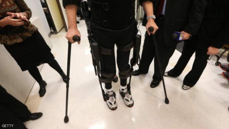 NEW YORK, NY - DECEMBER 06:  Forty three-year-old parapalegic Robert Woo stands while walking with an exoskeleton device made by Ekso Bionics during a demonstration at the opening of the Rehabilitation Bionics Program at Mount Sinai Rehabilitation Center on December 6, 2012 in New York City. Woo is an architect who was paralyzed from the hips down during a construction accident and thought he would never walk again. The new strap-on exoskelton uses motors and sensors to physically move the legs.  (Photo by Mario Tama/Getty Images)