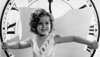26th December 1936:  American child star Shirley Temple celebrating the arrival of a new year.  (Photo by Fox Photos/Getty Images)