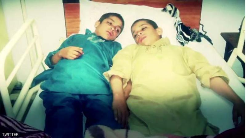 طفلان شمسيان