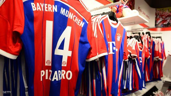 Bayern Munich team jerseys are on display in the fan shop  of German first division Bundesliga football club FC Bayern Muenchen in Berlin on November 29, 2014, during its inauguration. AFP PHOTO / JOHN MACDOUGALL        (Photo credit should read JOHN MACDOUGALL/AFP/Getty Images)