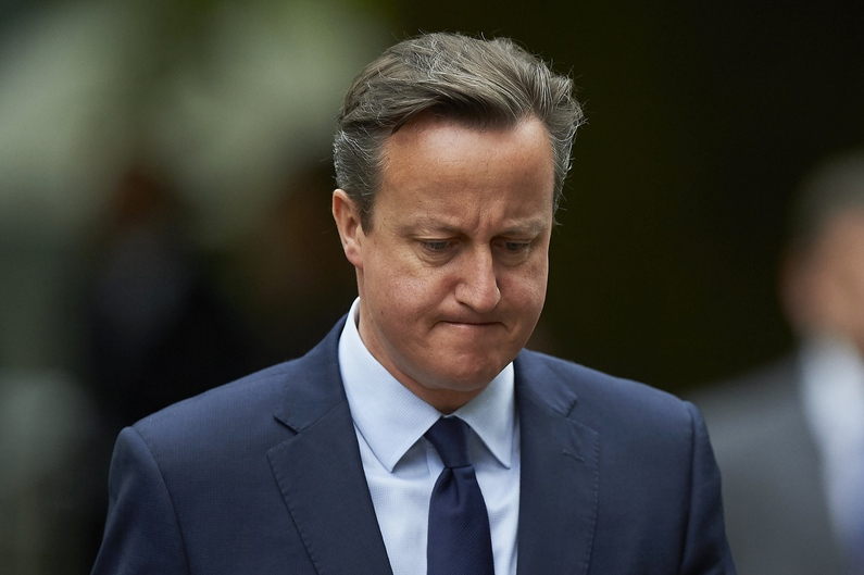 British Prime Minister David Cameron is pictured as he takes part in a wreath laying ceremony in London's Hyde Park on July 7, 2015, in memory of the 52 victims of the 7/7 London attacks. Britain on Tuesday marked 10 years since the London bombings with a minute's silence for the 52 victims, less than a fortnight after an attack in Tunisia highlighted the ongoing Islamist threat. AFP PHOTO / NIKLAS HALLE'N