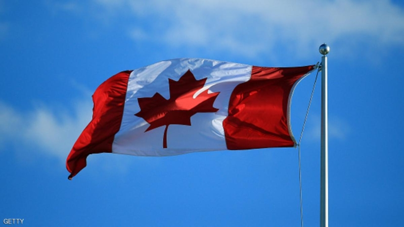 TORONTO, ON - JULY 25:  A Canada flag flies in the wind on Centre Court during Day 1 of the Rogers Cup at the Aviva Centre on July 25, 2016 in Toronto, Ontario, Canada.  (Photo by Vaughn Ridley/Getty Images)