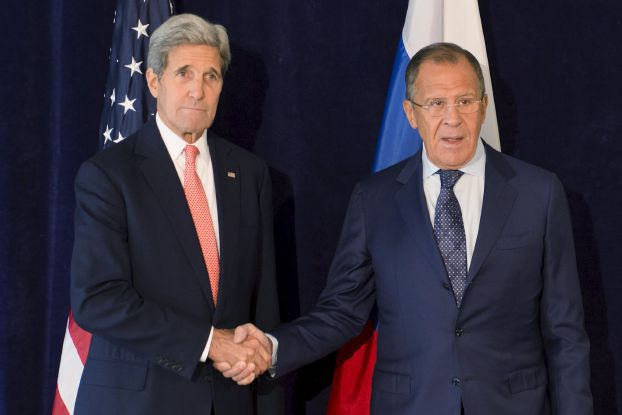 "U.S. Secretary of State John Kerry (L) poses with Russian Foreign Minister Sergei Lavrov during their meeting ahead of the United Nations General Assembly in New York September 27, 2015. Kerry and Lavrov on Sunday discussed Russia's military involvement in Syria, as well as ways to ""de-conflict"" and the possibility of a political transition for the war-ravaged country. REUTERS/Stephanie Keith"